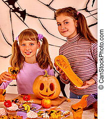 child holding make carved pumpkin. - Halloween party with...