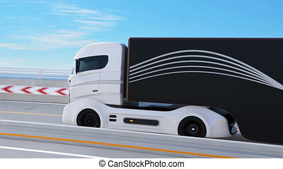 White truck driving on the highway - White truck passing a...
