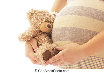 Pregnant woman on a white background with bear
