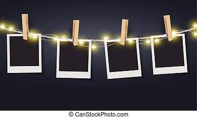 Blank photo frame hanging on rope with fairy lights - Vector...