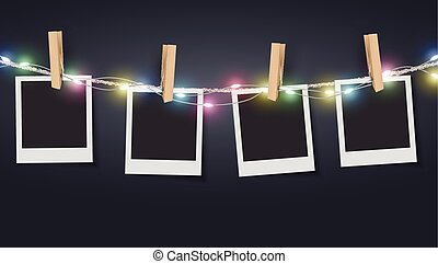 Blank photo frame hanging on rope with colorful fairy lights...
