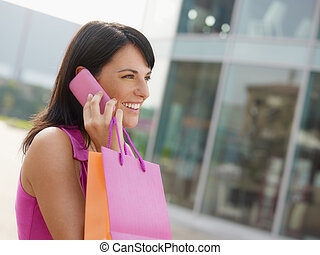 woman with shopping bags - mid adult italian woman talking...