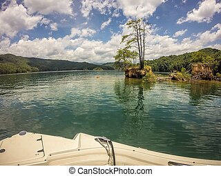 boating on a lake in the mountains