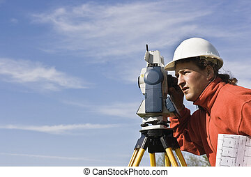 Land Surveying under cloudy sky