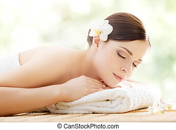 Young and beautiful girl relaxing in a spa salon - Young and...