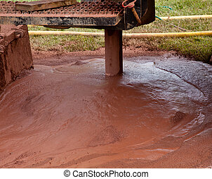 Drilling well in yard - Slurry of mud from drilling for...