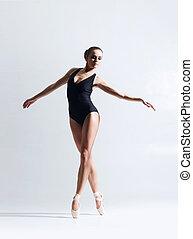 Graceful ballerina dancing in a studio