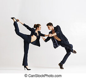 Couple of sporty ballet dancers performing in a studio.