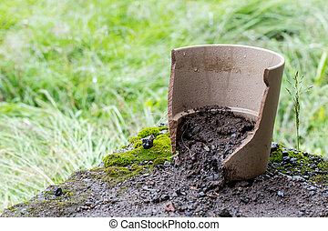 Broken flower pot, stil filled with dirt