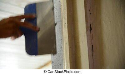 Plasterer apply the mixture on door Escarpment - Plasterer...
