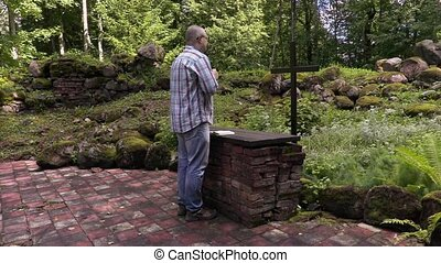 Man praying at the altar in outdoor church