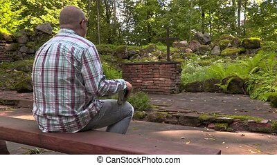 Man reading the Bible in outdoor church