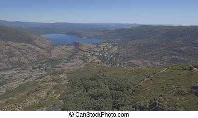 Flying off Sanabria Lake - Aerial view of canyon and...