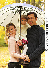 happy family playing outdoors portrait of autumn in the park
