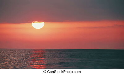 Sunset over the Sea. Time Lapse - Sunset orange sun over the...