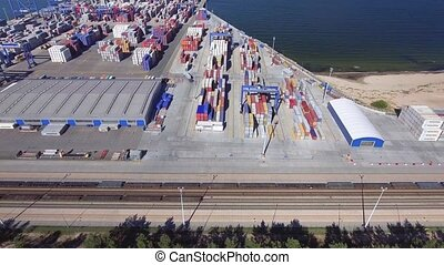 aerial view of big cargo port with sea containers
