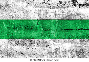 Flag of Groningen, Netherlands, painted on dirty wall