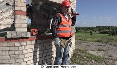 Angry builder with sledgehammer talking