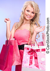 shopper - lovely woman with shopping bags over blue