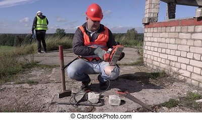Construction worker keep the power cord