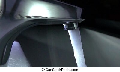 Water tap in action. Super slow motion close up shot, 1000...