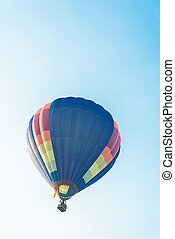 Hot balloon flying in the blue sky
