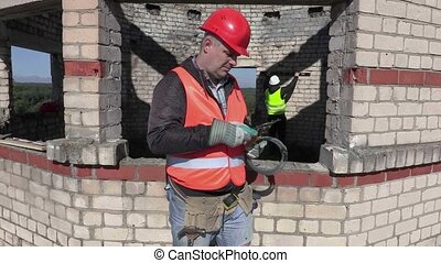 Construction worker with metal Cutting shears and mounting...