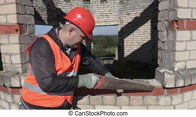 Construction worker with handsaw
