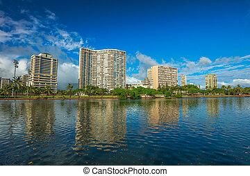 Ala Wai Canal Honolulu - Honolulu city skyline. Hotel and...