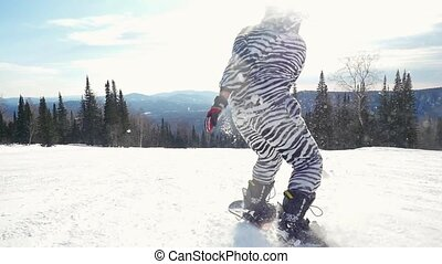 Snowboarder man in suit of kigurumi of zebra jumping and going in high mountains in slowmotion during snowfall. 1920x1080