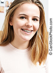 Portrait Of Smiling Teenage Girl Wearing Dental Braces
