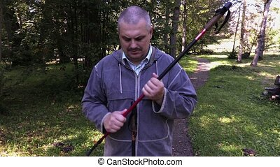 Hiker fix walking sticks