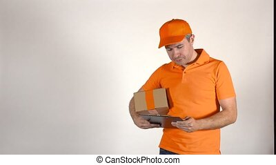 Courier in orange uniform delivering a parcel to wrong address. Mistake concept, 4K studio shot