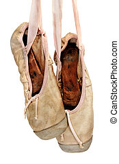 old pointe shoes - a pair of old pointe shoes isolated on a...