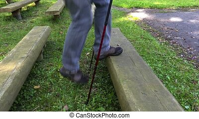 Hiker with walking sticks performs exercises