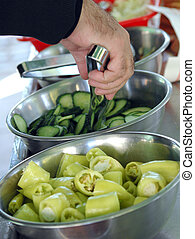 Cucumbers and paprikas in a metal bowl - picture of a...