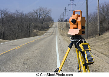 Theodolite set on the edge of road - spring land surveying