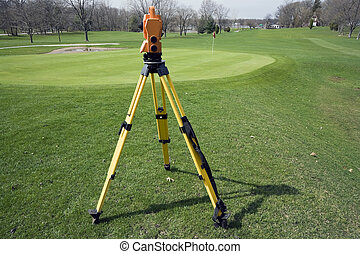 Land surveying the golf course - spring time.
