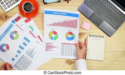 Woman Monitoring Stock Graphs - Hands Manager Monitoring...