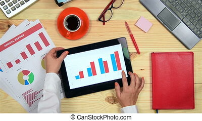 Woman Using Touch Pad With Chart - Businesswoman Using...