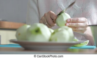 A woman peeled an apple on a plate. Part 4. Woman clears the...