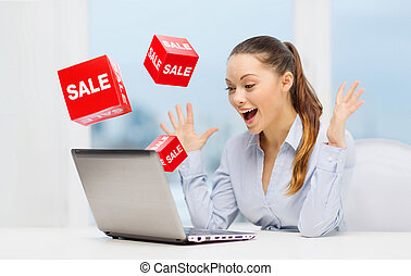 surprised businesswoman with laptop and sale signs