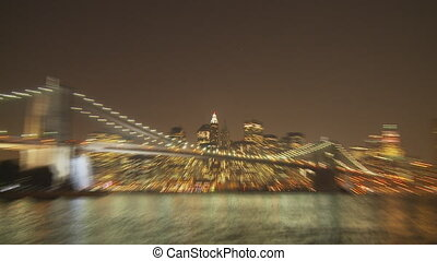zoom manhattan by night - zoom in empire state building by...