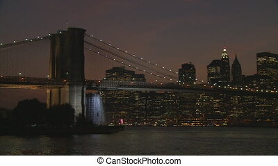 pan shot manhattan skyline night - pan shot brooklyn bridge...