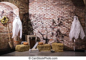 pumpkin in the hay, broom and ghosts - Halloween. pumpkin in...