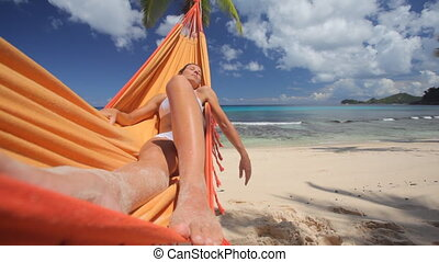 young woman in hammock close wideangle - woman in bikini...