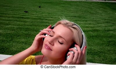 Pregnant woman with headphones listening to music