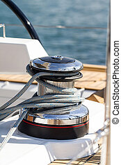Capstan on a sailboat - Rope around the capstan on a...