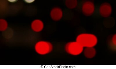 Defocused red night traffic lights urban night time in big...