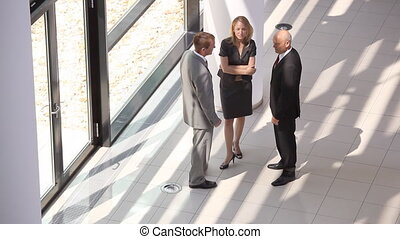 businessteam from top - three business people in discussion...